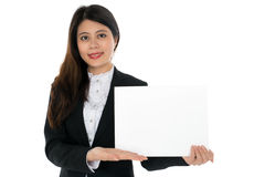 Businesswoman with Blank Sign. A Businesswoman with Blank Sign and smiling Stock Image