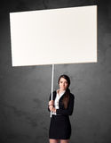 Businesswoman with blank whiteboard Royalty Free Stock Photo