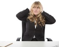 Businesswoman blocking her ears Royalty Free Stock Photos