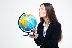 Businesswoman blowing on globe Stock Photos