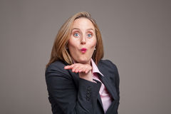 Businesswoman blowing a kiss royalty free stock photo
