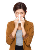 Businesswoman with blowing nose Royalty Free Stock Images