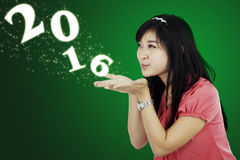 Businesswoman Blowing Numbers 2016 Stock Images