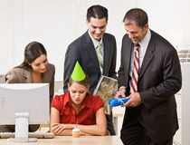 Businesswoman blowing out birthday candle Stock Photography
