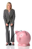 Businesswoman Blowing Up Piggy Bank. Isolated over white Royalty Free Stock Photo