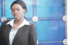 Businesswoman on a blue background Stock Photos