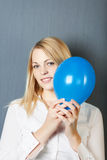 Businesswoman With Blue Balloon Near Her Face Royalty Free Stock Photo