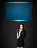 Businesswoman with blue board Stock Images
