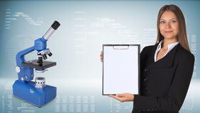Businesswoman with blue chemistry microscope Stock Images