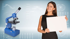 Businesswoman with blue chemistry microscope Stock Photo