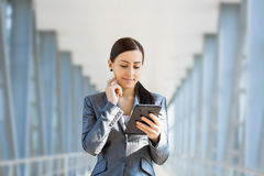 Businesswoman on the blue modern background Royalty Free Stock Photography