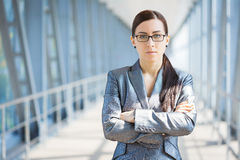 Businesswoman on the blue modern background Stock Photos