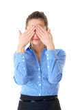 Businesswoman in blue shirt covers eyes, isolated Royalty Free Stock Image