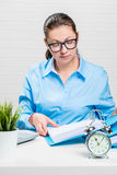 Businesswoman in blue shirt and glasses working Stock Photos