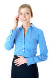 Businesswoman in blue shirt talks over mobile Royalty Free Stock Photography