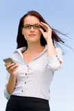 Businesswoman blue sky attractive look with phone Stock Photos