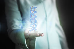 Businesswoman in blue suit. Usinesswoman in blue suit holding a DNA strain Stock Photos