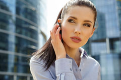 Businesswoman with Bluetooth Royalty Free Stock Images