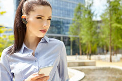 Businesswoman with Bluetooth Stock Images