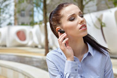 Businesswoman with Bluetooth Stock Image