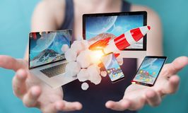 Businesswoman connecting tech devices and startup rocket 3D rend. Businesswoman on blurred background connecting tech devices and startup rocket 3D rendering Stock Image