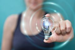 Businesswoman holding a lighbulb with connections in her hand Royalty Free Stock Photography