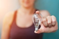 Businesswoman holding a lighbulb in her hand Royalty Free Stock Photography