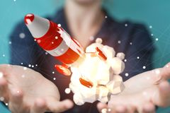 Businesswoman holding and touching red rocket 3D rendering. Businesswoman on blurred background holding and touching red rocket 3D rendering Stock Photo