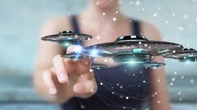 Businesswoman with retro UFO spaceship 3D rendering. Businesswoman on blurred background with retro UFO spaceship 3D rendering Royalty Free Stock Image