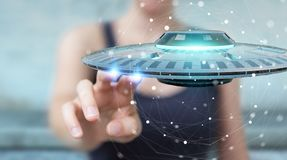 Businesswoman with retro UFO spaceship 3D rendering. Businesswoman on blurred background with retro UFO spaceship 3D rendering Stock Images