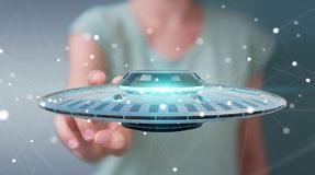 Businesswoman with retro UFO spaceship 3D rendering. Businesswoman on blurred background with retro UFO spaceship 3D rendering Stock Photo