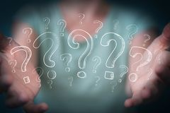 Businesswoman touching and holding hand drawn question marks Stock Images