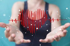 Businesswoman touching and holding heart beat sketch. Businesswoman on blurred background touching and holding heart beat sketch Royalty Free Stock Photography