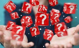 Businesswoman using cubes with 3D rendering question marks Royalty Free Stock Photos