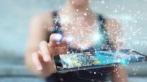 Businesswoman using digital binary code on mobile phone 3D rende. Businesswoman on blurred background using digital binary code on mobile phone 3D rendering Royalty Free Stock Photography