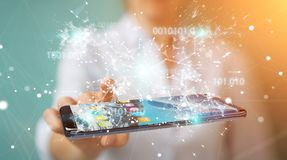 Businesswoman using digital binary code on mobile phone 3D rende. Businesswoman on blurred background using digital binary code on mobile phone 3D rendering Royalty Free Stock Photo