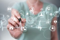 Businesswoman using digital medical interface with a pen 3D rend. Businesswoman on blurred background using digital medical interface with a pen 3D rendering Royalty Free Stock Images