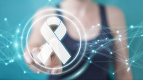 Businesswoman using digital ribbon cancer interface 3D rendering. Businesswoman on blurred background using digital ribbon cancer interface 3D rendering Royalty Free Stock Images