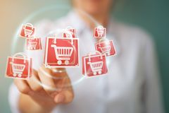 Businesswoman using digital shopping icons 3D rendering. Businesswoman on blurred background using digital shopping icons 3D rendering Royalty Free Stock Photography