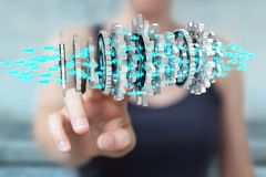 Businesswoman using floating modern gear mechanism 3D rendering. Businesswoman on blurred background using floating gear icons 3D rendering Stock Image