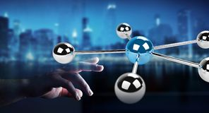 Businesswoman using flying 3D spheres network 3D rendering. Businesswoman on blurred background using flying 3D spheres network 3D rendering Royalty Free Stock Image