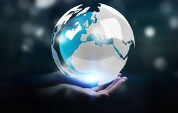 Businesswoman using flying white and blue 3D rendering earth. Businesswoman on blurred background using flying white and blue 3D rendering earth Stock Photos