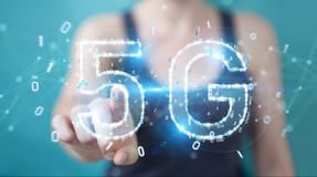 Businesswoman using 5G network digital hologram 3D rendering. Businesswoman on blurred background using 5G network digital hologram 3D rendering Stock Photo