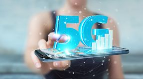 Businesswoman using 5G network with mobile phone 3D rendering. Businesswoman on blurred background using 5G network with mobile phone 3D rendering Stock Image