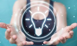 Businesswoman using lightbulb idea interface 3D rendering. Businesswoman on blurred background using lightbulb idea interface 3D rendering Royalty Free Stock Photography