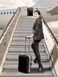 Businesswoman before boarding Royalty Free Stock Photo