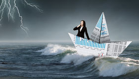 Businesswoman in boat made of paper Stock Image
