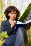 Businesswoman with a book. Stock Photo
