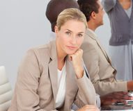 Businesswoman bored by a presentation Stock Photography