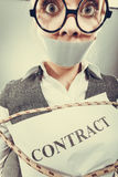 Businesswoman bound by contract with taped mouth. Stock Images